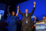 Democratic gubernatorial candidate and Kentucky Attorney General Andy Beshear, along with lieutenant governor candidate Jacqueline Coleman, acknowledge supporters at the Kentucky Democratic Party election night watch event, Tuesday, Nov. 5, 2019, in Louisville, Ky. (AP Photo/Bryan Woolston)