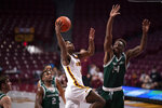Minnesota's Jamal Mashburn, Jr. (4) shoots while defended by Green Bay's Paris Taylor (14) during an NCAA college basketball game Wednesday, Nov. 25, 2020, in Minneapolis. (Jeff Wheeler/Star Tribune via AP)