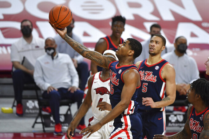 Mississippi guard Luis Rodriguez (15) drives to the hoop against Arkansas during the second half of an NCAA college basketball game Wednesday, Jan. 27, 2021, in Fayetteville, Ark. (AP Photo/Michael Woods)