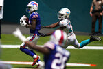Buffalo Bills wide receiver Stefon Diggs (14) scores a touchdown as Miami Dolphins cornerback Noah Igbinoghene (23) attempts to tackle, during the first half of an NFL football game, Sunday, Sept. 20, 2020 in Miami Gardens, Fla. (AP Photo/Wilfredo Lee)