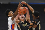 Army's Charlie Peterson reaches for a rebound between Florida's Omar Payne, left, and Army's Josh Caldwell, right, in the second half of an NCAA college basketball game, Wednesday, Dec. 2, 2020, in Uncasville, Conn. (AP Photo/Jessica Hill)