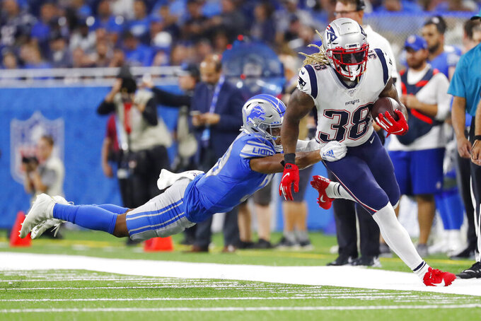 Detroit Lions cornerback Jamal Agnew grabs New England Patriots running back Brandon Bolden (38) during the first half of a preseason NFL football game Thursday, Aug. 8, 2019, in Detroit. (AP Photo/Rick Osentoski)