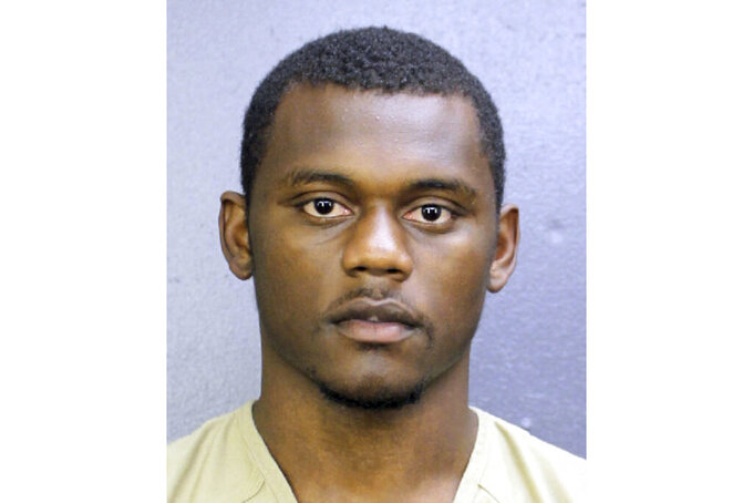 This booking photo provided by the Broward County, Fla., Sheriff's Office shows DeAndre Baker. The New York Giants cornerback surrendered to police Saturday, May 16, 2020, after being charged with robbing people of money and valuables at a cookout he was attending with another NFL football player. Baker is charged with four counts of armed robbery with a firearm and four counts of aggravated assault with a firearm. He turned himself in at the Broward County Jail. (Broward County Sheriff's Office via AP)