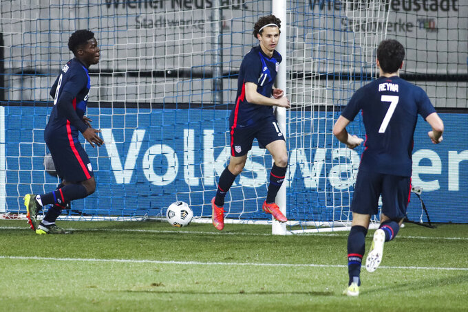 US players celebrate after scoring their second goal during the international friendly soccer match between USA and Jamaica at SC Wiener Neustadt stadium in Wiener Neustadt, Austria, Thursday, March 25, 2021. (AP Photo/Ronald Zak)