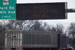 A tractor-trailer heads westbound on Interstate 70 near the Ward Road exit as a message flashes on the travel board as a statewide stay-at-home order takes effect to reduce the spread of the new coronavirus Thursday, March 26, 2020, in Wheat Ridge, Colo. The new coronavirus causes mild or moderate symptoms for most people, but for some, especially older adults and people with existing health problems, it can cause more severe illness or death. (AP Photo/David Zalubowski)