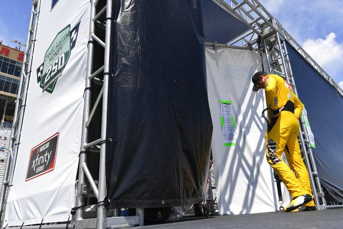 Kyle Busch waits to be introduced before a NASCAR Xfinity Series auto race Saturday, July 10, 2021, in Hampton, Ga. (AP Photo/John Amis)