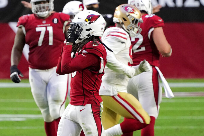 Arizona Cardinals wide receiver DeAndre Hopkins, reacts after missing a catch against the San Francisco 49ers during the second half of an NFL football game, Saturday, Dec. 26, 2020, in Glendale, Ariz. (AP Photo/Rick Scuteri)