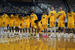 Michigan forward Isaiah Livers kneels during the national anthem before an NCAA college basketball game against Toledo in Ann Arbor, Mich., Wednesday, Dec. 9, 2020. (AP Photo/Paul Sancya)