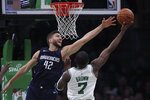 Dallas Mavericks center Maxi Kleber (42) tries to block Boston Celtics guard Jaylen Brown (7) during the second half of an NBA basketball game in Boston, Monday, Nov. 11, 2019. The Celtics defeated the Mavericks 116-106. (AP Photo/Charles Krupa)