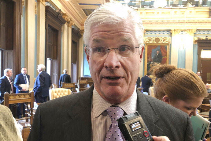 Senate Majority Leader Mike Shirkey, R-Clarklake, speaks about a budget agreement Tuesday, Dec. 10, 2019, inside the Michigan Senate in Lansing, Mich. The Senate unanimously passed bills to restore more than half of the funding vetoed by Gov. Gretchen Whitmer in late September. (AP Photo/David Eggert)