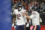Chicago Bears wide receiver Allen Robinson (12) and quarterback Chase Daniel (4) celebrate a touchdown during the second half of an NFL football game against the Oakland Raiders at Tottenham Hotspur Stadium, Sunday, Oct. 6, 2019, in London. (AP Photo/Tim Ireland)