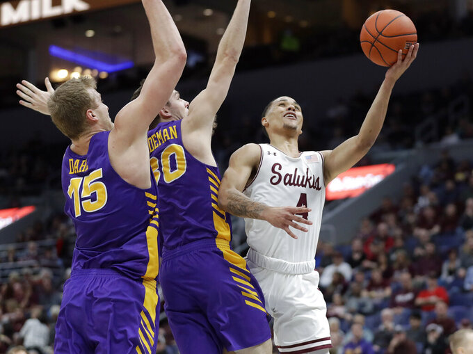 Southern Illinois' Eric McGill (4) heads to the basket past Northern Iowa's Justin Dahl and Spencer Haldeman (30) during the first half of an NCAA college basketball game in the quarterfinals of the Missouri Valley Conference men's tournament Friday, March 8, 2019, in St. Louis. (AP Photo/Jeff Roberson)