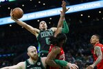 Boston Celtics' Jayson Tatum (0) shoots against Houston Rockets' Nene Hilario, lower right, during the first half of an NBA basketball game in Boston, Sunday, March 3, 2019. (AP Photo/Michael Dwyer)