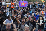 Catalan pro-independence demonstrators sit in the street in Barcelona, Spain, Saturday, Oct. 19, 2019. Barcelona and the rest of the restive Spanish region of Catalonia are reeling from five straight days of violent protests for the sentencing of 12 separatist leaders to lengthy prison sentences.The riots have broken out at nightfall following huge peaceful protests each day since Monday's Supreme Court verdict. (AP Photo/Manu Fernandez)