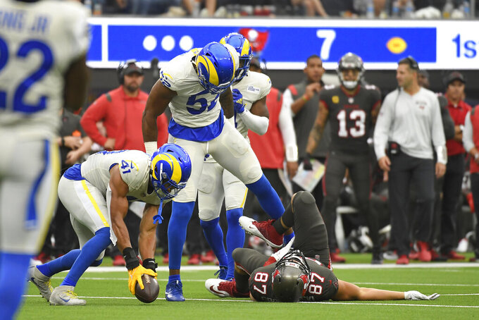 Tampa Bay Buccaneers tight end Rob Gronkowski (87) lays on the ground after being hit by Los Angeles Rams linebacker Terrell Lewis (52) during the second half of an NFL football game Sunday, Sept. 26, 2021, in Inglewood, Calif. (AP Photo/Kevork Djansezian)