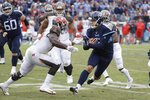 Tennessee Titans kick holder Brett Kern (6) is stopped by Tampa Bay Buccaneers linebacker Devin White on a fake field goal play in the second half of an NFL football game Sunday, Oct. 27, 2019, in Nashville, Tenn. (AP Photo/James Kenney)