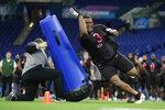 "FILE - In this Feb. 29, 2020, file photo, Auburn defensive lineman Derrick Brown runs a drill at the NFL football scouting combine in Indianapolis. Atlanta Falcons  coach Dan Quinn says the NFC South ""is turning into Quarterback South."" The priority to ""bring it"" on defense was evident in the NFL draft. (AP Photo/Michael Conroy, File)"
