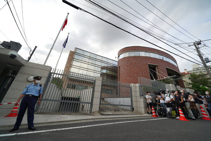 Media crews gather in front of the Embassy of Poland in Tokyo, Japan, after Belarusian Olympic athlete Krystsina Tsimanouskaya visited the embassy Monday, Aug. 2, 2021. The Olympic sprinter plans to seek asylum in Poland after alleging that officials tried to force her home, where she feared for her safety, an activist group said Monday. (AP Photo/Kantaro Komiya)