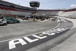 Work goes on in the infield behind an All-Star Race logo before the NASCAR All-Star auto race at Bristol Motor Speedway in Bristol, Tenn, Wednesday, July 15, 2020. (AP Photo/Mark Humphrey)