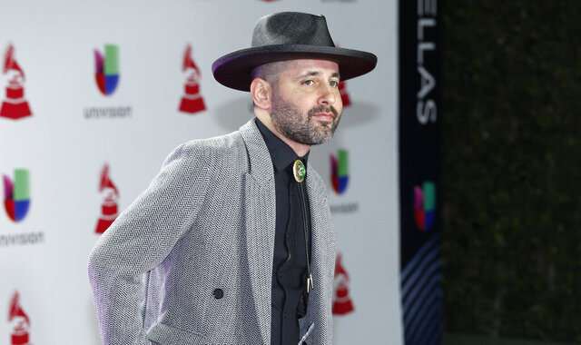 FILE - In this Nov. 15, 2018, file photo, Eduardo Cabra, of Calle 13, arrives at the Latin Grammy Awards in Las Vegas. Cabra killed off his
