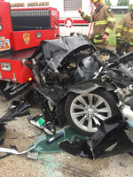 FILE - In this Friday, May 11, 2018, file photo, released by the South Jordan Police Department shows a traffic collision involving a Tesla Model S sedan with a Fire Department mechanic truck stopped at a red light in South Jordan, Utah. The driver of a Tesla electric car that hit a Utah fire department vehicle over the weekend says the car's semi-autonomous Autopilot mode was engaged at the time of the crash. Police in the Salt Lake City suburb of South Jordan said Monday, May 14, 2018, the driver also said in an interview that she was looking at her phone before the accident. The 28-year-old woman broke her foot when her car hit a fire truck stopped at a red light while going 60 mph (97 kph). (South Jordan Police Department via AP, File)