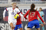 FILE - In this Sunday, Nov. 10, 2019 file photo, U.S. midfielder Allie Long (20) goes after the ball in front of Costa Rica forward Maria Paula Salas (17) during the second half of an international friendly soccer match in Jacksonville, Fla. Allie Long is likely the only National Women's Soccer League Player that launched a new career while sheltering at home. Long has been playing video games on Twitch and has built a solid reputation in the gaming world – so much so that she's been able to raise some serious money for charities, while also educating fellow gamers about women's soccer.  (AP Photo/John Raoux, File)