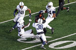 Rutgers wide receiver Bo Melton is tackled by Penn State safety Lamont Wade (38) during the first half of an NCAA college football game Saturday, Dec. 5, 2020, in Piscataway, N.J. (AP Photo/Adam Hunger)