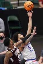 Mississippi State guard D.J. Stewart Jr. (3) defends as Louisiana Tech guard Kalob Ledoux (5) takes a shot in the first half of an NCAA college basketball game in the semifinals of the NIT, Saturday, March 27, 2021, in Frisco, Texas. (AP Photo/Tony Gutierrez)