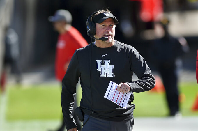 Houston head coach Dana Holgorsen on the sidelines during the second half of an NCAA college football game against Connecticut, Saturday, Oct. 19, 2019, in East Hartford, Conn. (AP Photo/Stephen Dunn)