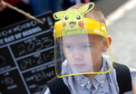Evan Seppa, Class of 2033, sports a Pikachu face shield for his first day of kindergarten at Elizabeth Page Elementary Sept. 21, 2020, in Springfield, Ore. The Springfield Public School District started in-person instruction for kindergarten and first grade students this week and will expand in coming weeks to include second and third grade students. (Andy Nelson/The Register-Guard via AP)