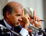 FILE - In this Oct. 12, 1991, file photo, Senate Committee Chairman Joseph Biden, D-Del., gestures during hearings before the committee on allegations of sexual harassment by Supreme Court nominee Clarence Thomas on Capitol Hill in Washington. (AP Photo/Greg Gibson, File)