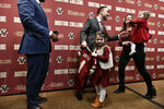 Jeff Hafley, center, welcomes his wife, Gina Hafley and their daughters Hope, 4, and Leah, 1, following a news conference where he was introduced as the new NCAA college football head coach at Boston College, Monday, Dec. 16, 2019, in Boston. (AP Photo/Josh Reynolds)