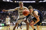 Purdue center Matt Haarms (32) and Michigan center Jon Teske (15) go for a loose ball during the second half of an NCAA college basketball game in West Lafayette, Ind., Saturday, Feb. 22, 2020. (AP Photo/Michael Conroy)