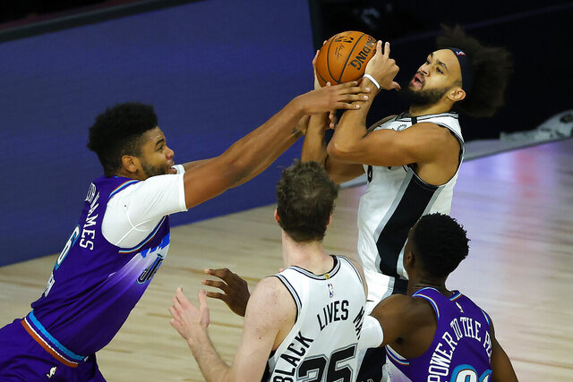 Utah Jazz' Juwan Morgan (16), fouls San Antonio Spurs' Derrick White during second half of an NBA basketball game Friday, Aug. 7, 2020, in Lake Buena Vista, Fla. (Kevin C. Cox/Pool Photo via AP)