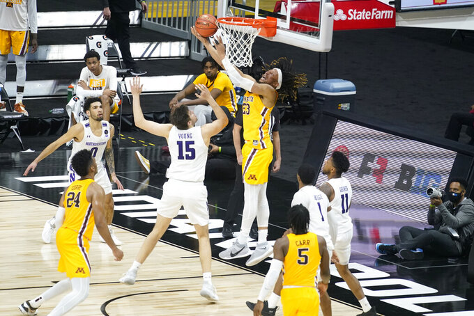 Minnesota's Brandon Johnson (23) puts up a shot against Northwestern's Ryan Young (15) during the second half of an NCAA college basketball game at the Big Ten Conference tournament, Wednesday, March 10, 2021, in Indianapolis. Minnesota won 51-46. (AP Photo/Darron Cummings)