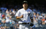 New York Yankees starting pitcher Masahiro Tanaka walks to the dugout after the sixth inning of a baseball game against the Tampa Bay Rays , Saturday, May 18, 2019, in New York. (AP Photo/Jim McIsaac)