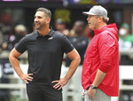 First-time head coaches, Atlanta Falcons' Arthur Smith, right, and Philadelphia Eagles' Nick Sirianni, left, greet each other at midfield as the two prepare to face off in the first NFL football game of their head coaching careers, Sunday, Sept. 12, 2021, in Atlanta. (Curtis Compton/Atlanta Journal-Constitution via AP)