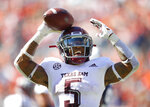 Texas A&M running back Trayveon Williams (5) reacts after scoring a touchdown against Auburn during the second half of an NCAA college football game, Saturday, Nov. 3, 2018, in Auburn, Ala. (AP Photo/Todd Kirkland)
