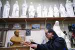 In this Nov. 16, 2019, photo, Mitsuho Nakata, a Catholic statue artist, works at his workshop near the Urakami Cathedral in Nagasaki, southern Japan. Pope Francis will start his first official visit to Japan in Nagasaki, ground zero for the Christian experience in a nation where the Catholic leader once dreamed of living as a missionary. (AP Photo/Eugene Hoshiko)