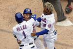 New York Mets' Javier Baez celebrates with Jonathan Villar and Francisco Lindor, right, after scoring the game winning run against the Miami Marlins during the ninth inning of the first game of a baseball doubleheader that started April 11 and was suspended because of rain, Tuesday, Aug. 31, 2021, in New York. The Mets won 6-5. (AP Photo/Adam Hunger)