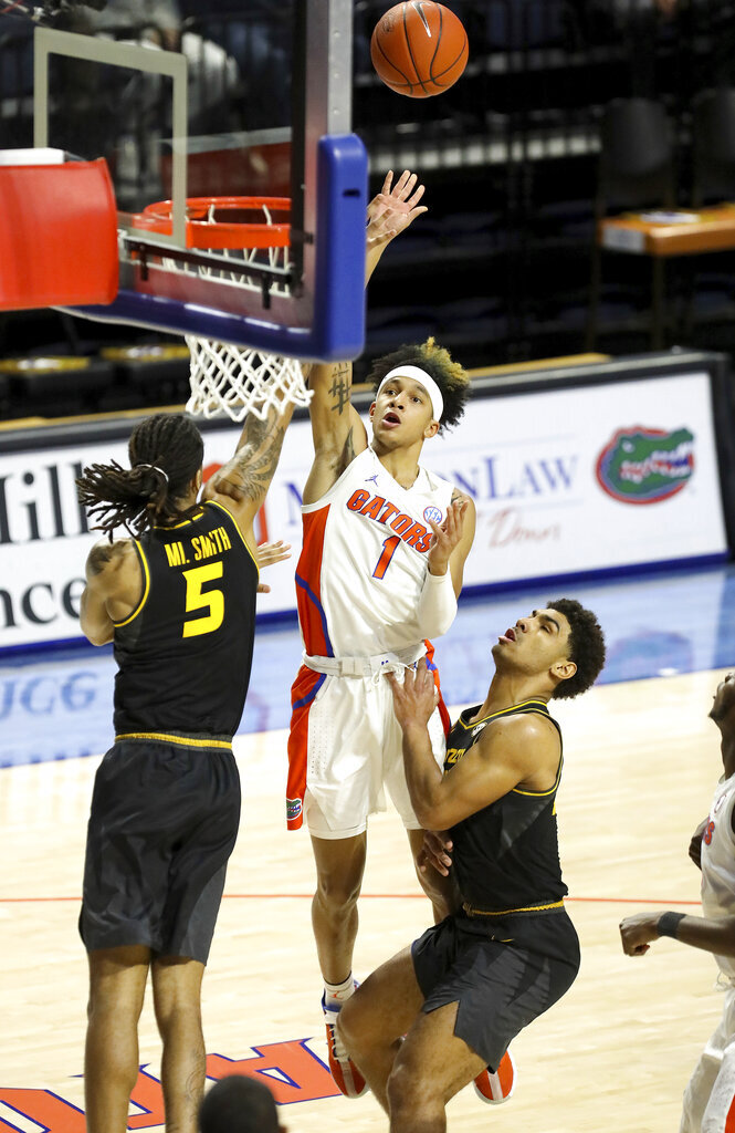 Florida guard Tre Mann (1) scores on a floater he puts up over the Missouri defense during an NCAA college basketball game, Wednesday, March 3, 2021 in Gainesville, Fla. (Brad McClenny/The Gainesville Sun via AP)
