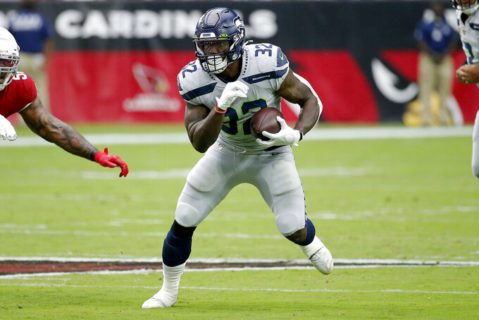 Seattle Seahawks running back Chris Carson (32) runs the ball against the Arizona Cardinals during the first half of an NFL football game, Sunday, Sept. 29, 2019, in Glendale, Ariz. (AP Photo/Rick Scuteri)