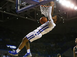 Buffalo guard Jayvon Graves (3) dunks during the second half of the team's NCAA college basketball game against Ball State, Tuesday, Jan. 29, 2019, in Buffalo, N.Y. (AP Photo/Jeffrey T. Barnes)
