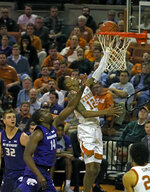 Texas guard Kerwin Roach II (12) lays up the ball against Kansas State forward Makol Mawien (14) during the first half of an NCAA college basketball game, Tuesday, Feb. 12, 2019, in Austin, Texas. (AP Photo/Michael Thomas)