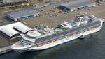 The cruise ship Diamond Princess is docked at Yokohama Port, near Tokyo, Friday, Feb. 7, 2020. Japan on Friday reported 41 new cases of a virus on the cruise ship that's been quarantined. About 3,700 people have been confined aboard the ship. (Sadayuki Goto/Kyodo News via AP)