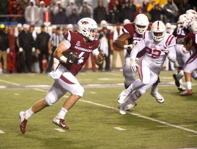 Arkansas quarterback Ty Storey carries the ball against Mississippi during the first half of an NCAA college football game Saturday, Oct. 13, 2018, in Little Rock, Ark. (AP Photo/Michael Woods)