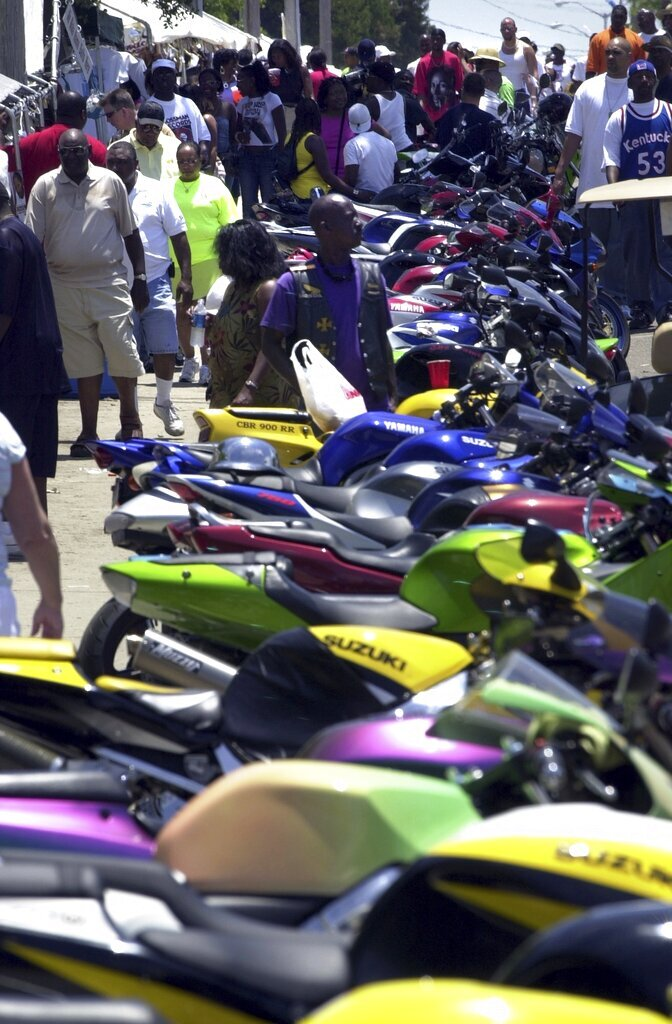 FILE- In this May 29, 2005 file photo, colorful motorcycles stand in line in Atlantic Beach S.C., during the 2005 Atlantic Beach Bikefest. The city of Myrtle Beach in South Carolina is in the second week of a federal trial over whether it discriminates against thousands of Black tourists who visit every May to celebrate motorcycle culture. (Randall Hill/The Sun News via AP, File)