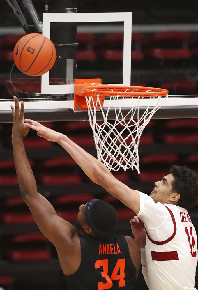 Oregon State forward Rodrigue Andela (34) shoots against Stanford forward Jaiden Delaire (11) during the second half of an NCAA college basketball game in Stanford, Calif., Saturday, Feb. 27, 2021. (AP Photo/Josie Lepe)
