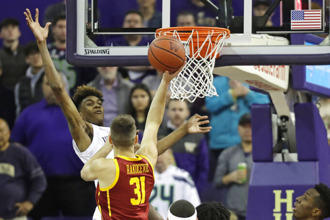 Washington forward Jaden McDaniels, left, blocks a shot by Southern California forward Nick Rakocevic (31) during the first half of an NCAA college basketball game, Sunday, Jan. 5, 2020, in Seattle. (AP Photo/Ted S. Warren)