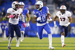 Kentucky running back Asim Rose (10) runs with the ball during the first half of an NCAA college football game against UT Martin, Saturday, Nov. 23, 2019, in Lexington, Ky. (AP Photo/Bryan Woolston)